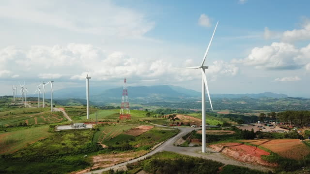 aerial view of wind turbines with blue sky, dolly shot - turbine stock videos & royalty-free footage