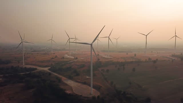 aerial view of wind turbines with sunrise alternative energy - documentary footage stock videos & royalty-free footage