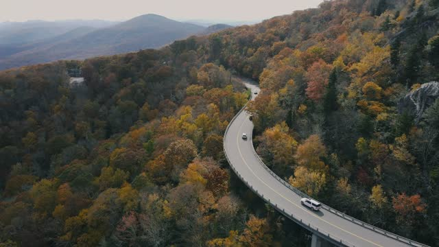 aerial view of winding mountain road in the fall - mountain road stock videos & royalty-free footage