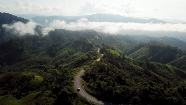 aerial view of winding road on the mountain and car driving , safety driving concept - winding road stock videos & royalty-free footage