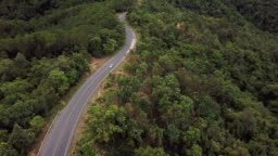 Aerial view of Winding road on the mountain and car driving , Safety Driving concept