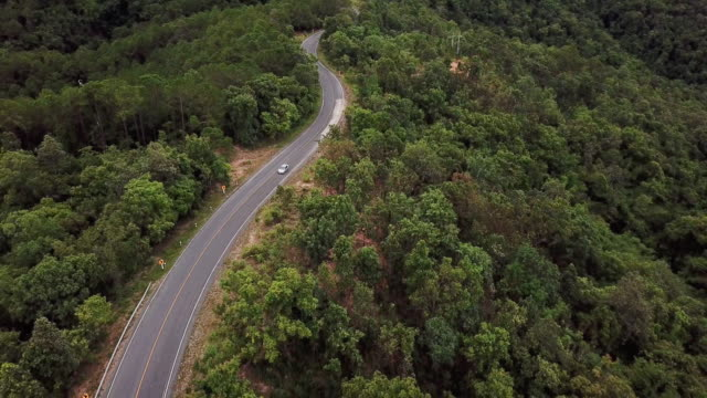 aerial view of winding road on the mountain and car driving , safety driving concept - curve stock videos and b-roll footage