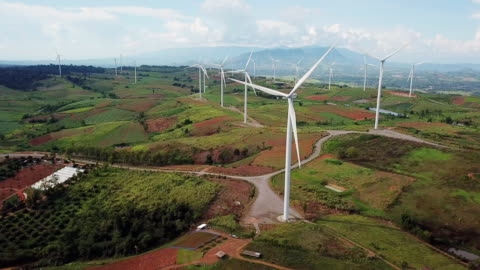 aerial view of windmill alternative energy , wind turbine - power in nature stock videos & royalty-free footage