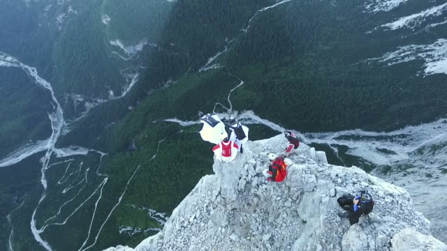 aerial view of wingsuit pilots jumping off cliff - cliff stock videos & royalty-free footage