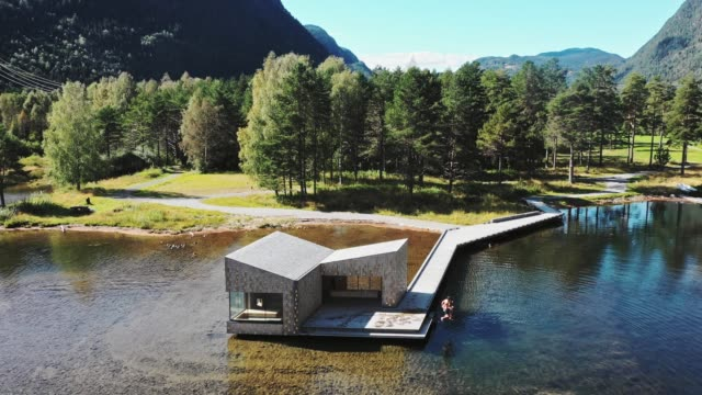 aerial view of woman jumping into the lake after sauna  in norway - sauna stock videos & royalty-free footage