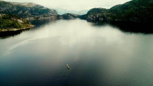 aerial view of woman kayaking on the lake in mountains - kayak stock videos & royalty-free footage