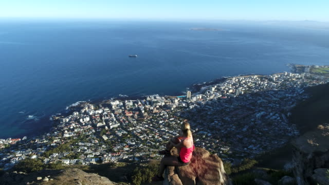 aerial view of woman on mountain top - lion's head mountain stock videos and b-roll footage
