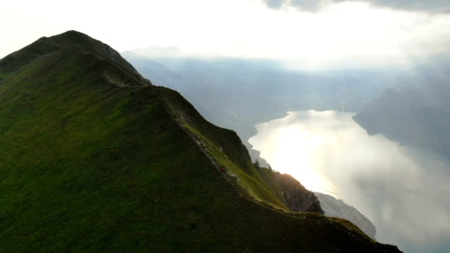 aerial view of woman running on the mountain ridge in swiss alps - hill stock videos & royalty-free footage