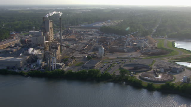 aerial view of wood fibre mill on the savannah river, savannah, georgia, united states of america - pulp stock videos & royalty-free footage