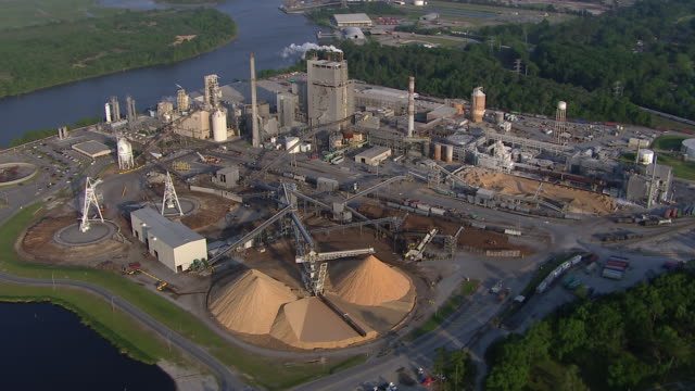 aerial view of wood fibre mill on the savannah river, savannah, georgia, united states of america - paper mill stock videos & royalty-free footage