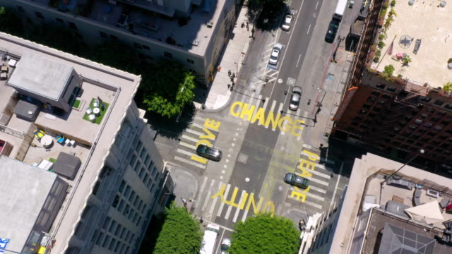aerial view of words painted on city street during george floyd protests - anti racism stock videos & royalty-free footage