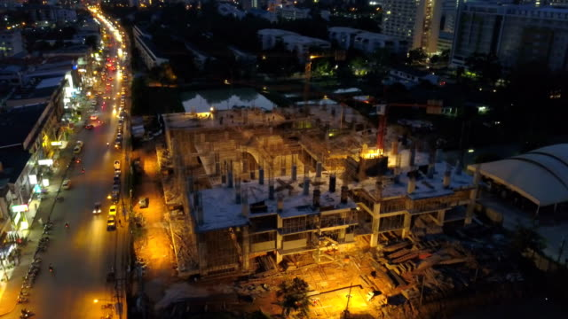 Aerial view of working Construction site in city at night