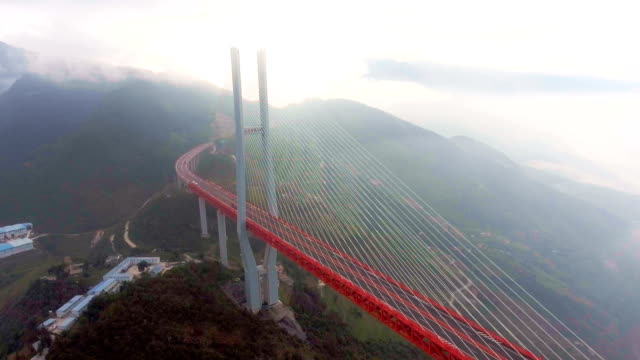 aerial view of world's highest suspension bridge, beipanjiang, ghuizhou, china - musical instrument bridge stock videos & royalty-free footage