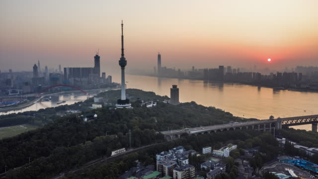 aerial view of wuhan skyline at sunrise - river han stock videos & royalty-free footage