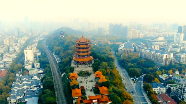 aerial view of wuhan yellow crane tower - temple building stock videos & royalty-free footage