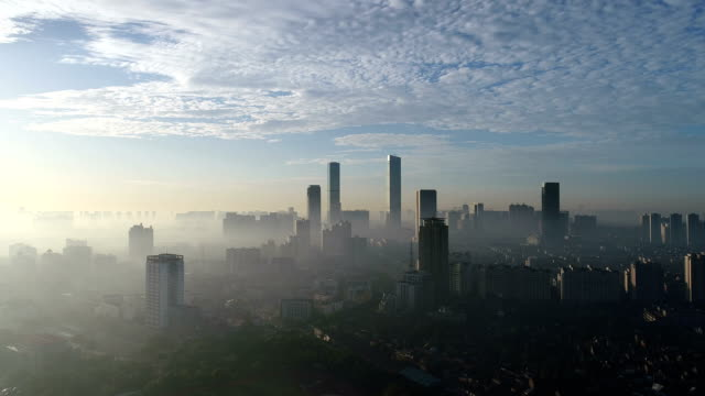 aerial view of wuxi center - schwenk nach unten stock-videos und b-roll-filmmaterial