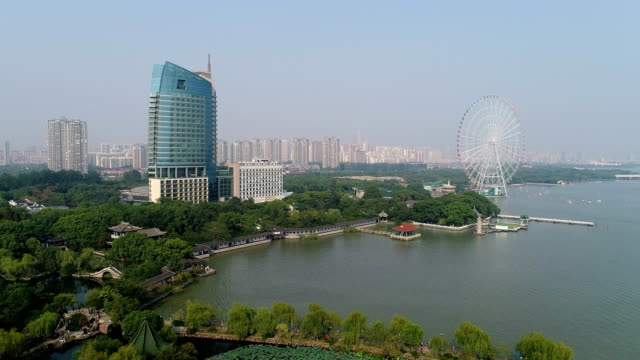 stockvideo's en b-roll-footage met aerial view of wuxi liyuan scenic area - tuinpad