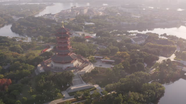 stockvideo's en b-roll-footage met aerial view of xiamen yuanbo garden, with a chinese traditional pagoda tower at dusk - plaatselijk monument