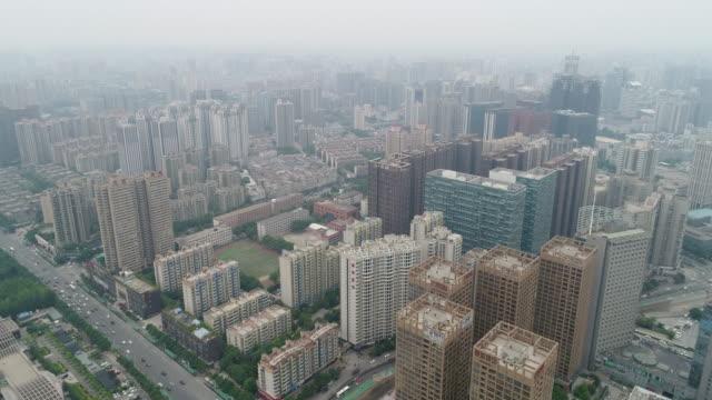 vidéos et rushes de aerial view of xi'an in smog - smog