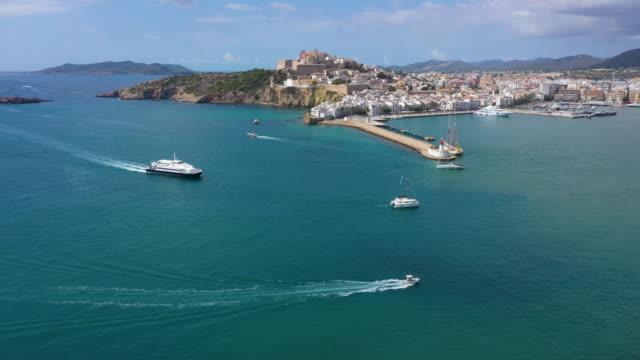 aerial view of yacht near ibiza town, castell de eivissa. balearic islands, spain - 地中海点の映像素材/bロール