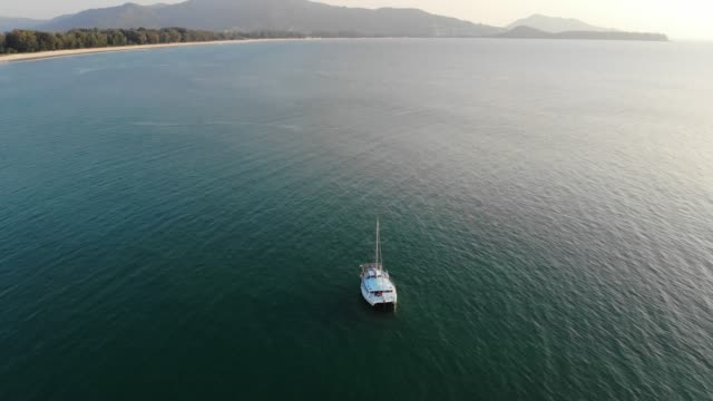 aerial view of yacht with sunset - phuket stock videos & royalty-free footage