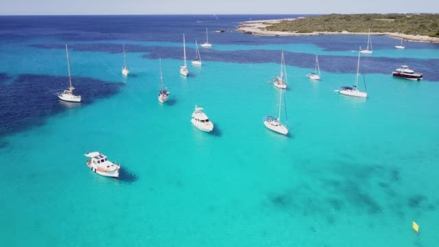 aerial view of yachts and boats in crystal clear sea, spain - minorca stock videos & royalty-free footage