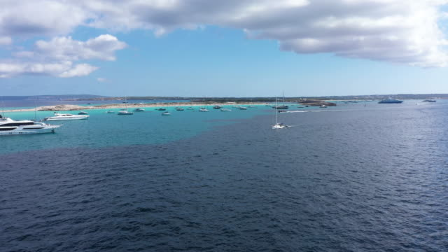 aerial view of yachts in turquoise water near formentera. balearic islands, spain - 地中海点の映像素材/bロール