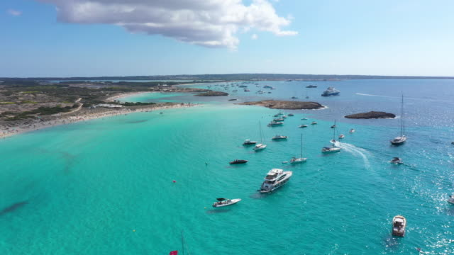 aerial view of yachts in turquoise water near formentera. balearic islands, spain - yachting stock videos & royalty-free footage