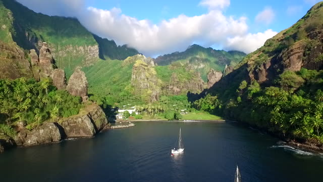 aerial view of yachts moored in hana vave, the bay of virgins, on fatu hiva - french overseas territory stock videos & royalty-free footage
