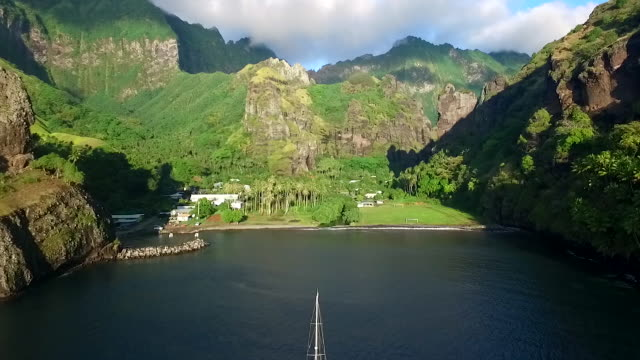 stockvideo's en b-roll-footage met aerial view of yachts moored in hana vave, the bay of virgins, on fatu hiva - frans polynesië