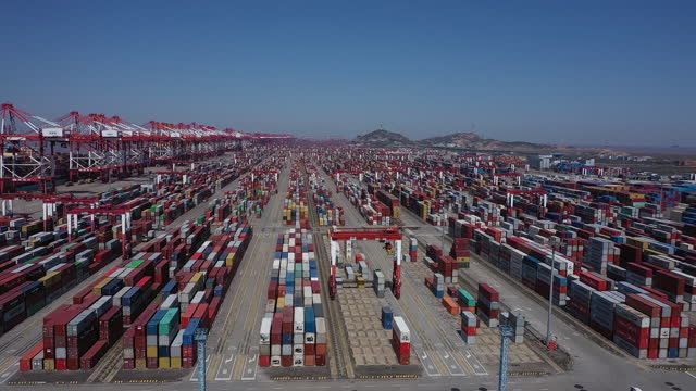 aerial view of yangshan port ahead of trade figures release, in shanghai, china, on friday, april 9, 2021. china is scheduled to release trade... - container video stock e b–roll