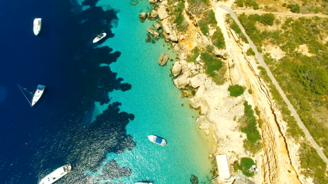 aerial view of yatch in amazing, unspoiled and idyllic beach on a little island - silvestre video stock e b–roll