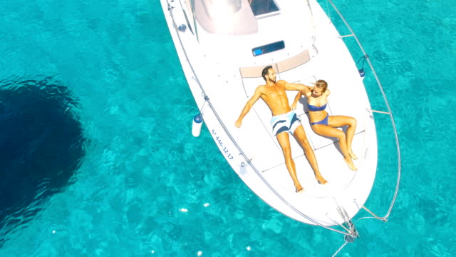 Aerial view of Yatch in amazing, unspoiled and idyllic beach