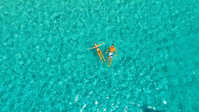 aerial view of yatch in amazing, unspoiled and idyllic beach - two people stock videos & royalty-free footage
