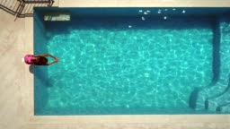 Aerial view of young woman diving into swimming pool.