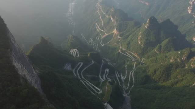 aerial view of zhangjiajie national forest park and main roads to tianmen mountain - china stock-videos und b-roll-filmmaterial