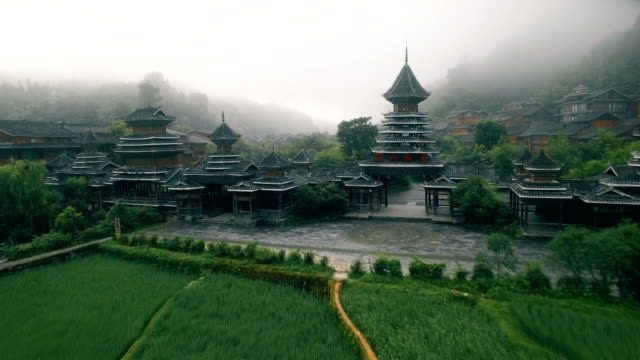 aerial view of zhaoxing dong village at morning, guizhou, china - pagoda stock videos & royalty-free footage
