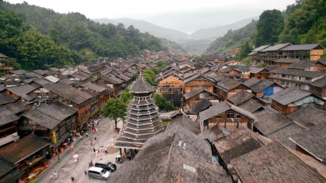 flygfoto av zhaoxing dong village på morning, guizhou, kina - klocktorn bildbanksvideor och videomaterial från bakom kulisserna