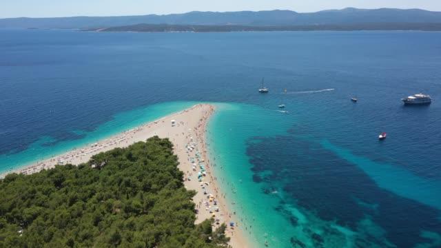 aerial view of zlatni rat beach, bol, croatia - croatia stock videos & royalty-free footage