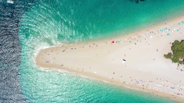 aerial view of zlatni rat beach, bol, croatia - bol stock videos & royalty-free footage