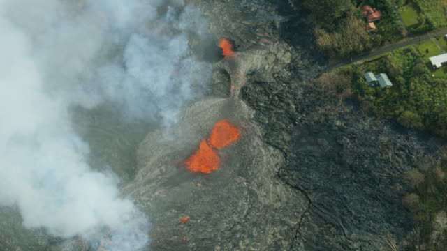aerial view off lava destroying landscape kilauea hawaii - erupting stock videos and b-roll footage