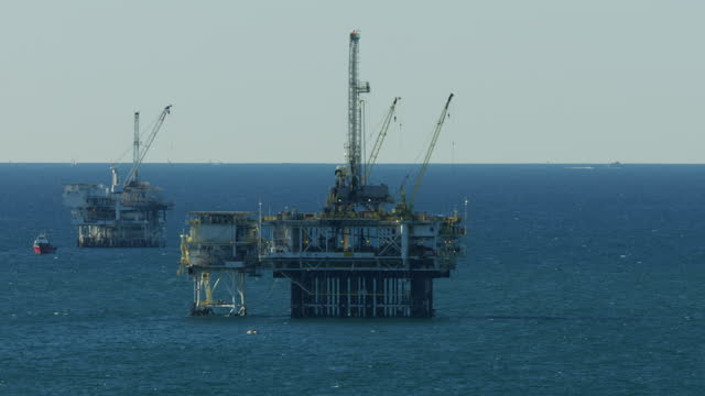 aerial view off shore oil drilling rigs california - fossil fuel stock videos & royalty-free footage