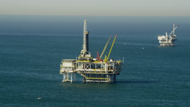 aerial view oil drilling platform offshore los angeles - fossil fuel stock videos and b-roll footage