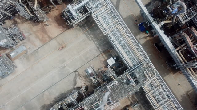 aerial view oil refinery facilities - silo stock videos & royalty-free footage