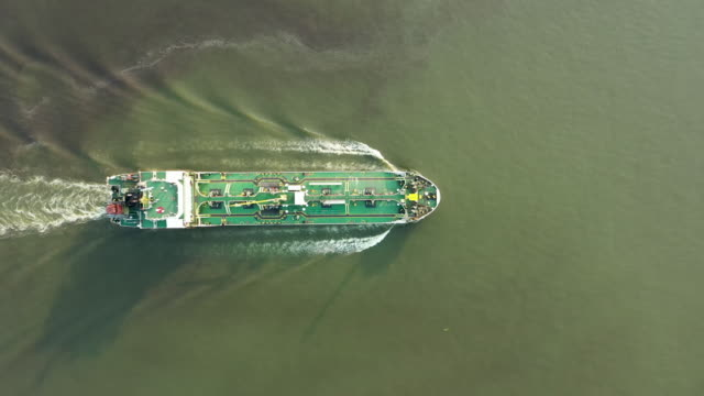 aerial view oil ship tanker full speed with beautiful wave pattern for transportation or energy concept background. - motor oil stock videos & royalty-free footage