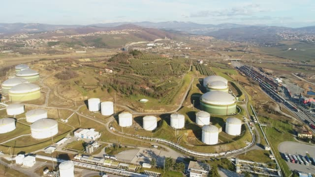 aerial view oil storage tanks among sunny landscape,slovenia - storage tank stock videos & royalty-free footage