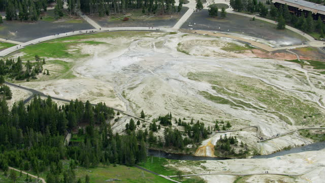 aerial view old faithful visitor center yellowstone wyoming - old faithful stock videos & royalty-free footage