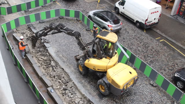 aerial view on a construction site in the street, renovation of a road - paving stone stock videos and b-roll footage