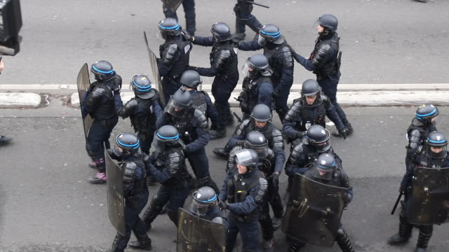 aerial view on backing police during a day of protest and ongoing transport worker strikes over french pension reform plans on january 11, 2020 in... - reform stock-videos und b-roll-filmmaterial