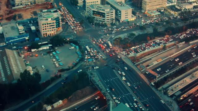 aerial view on busy urban rush hour traffic in tel aviv at twilight - spoonfilm stock-videos und b-roll-filmmaterial